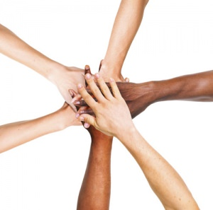 hands in the center from many ethnic persons