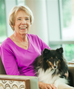 Volunteer Betty Wiese and therapy dog Kenzie