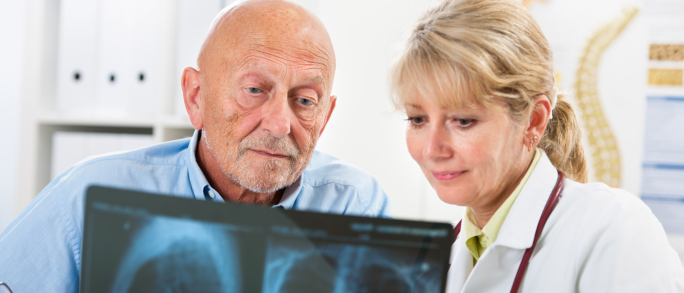 Doctor and Patient looking at Scan of Lungs