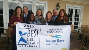 Indian River Medical Center staff holding the 2017 Best places to work award banner